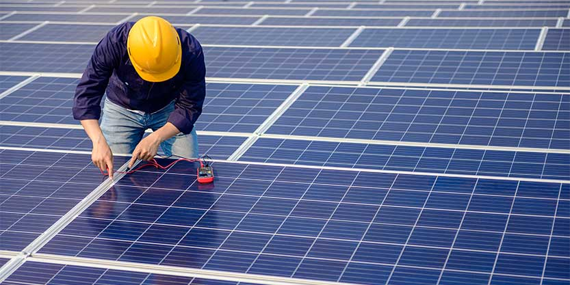 Man setting up solar pannel